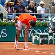 PARIS, FRANCE June 06. Novak Djokovic of Serbia checks a line call decision doing his match against Alexander Zverev of Germany on Court Philippe-Chatrier during the Men's Singles Quarter Final match at the 2019 French Open Tennis Tournament at Roland Garros on June 6th 2019 in Paris, France. (Photo by Tim Clayton/Corbis via Getty Images)