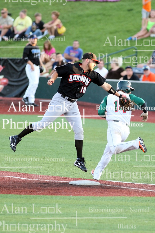 11 July 2012:  Joash Brodin (London Rippers) applies a tag to the back of runner Abel Nieves (Joliet Slammers) but not before he can cross 1st base during the Frontier League All Star Baseball game at Corn Crib Stadium on the campus of Heartland Community College in Normal Illinois