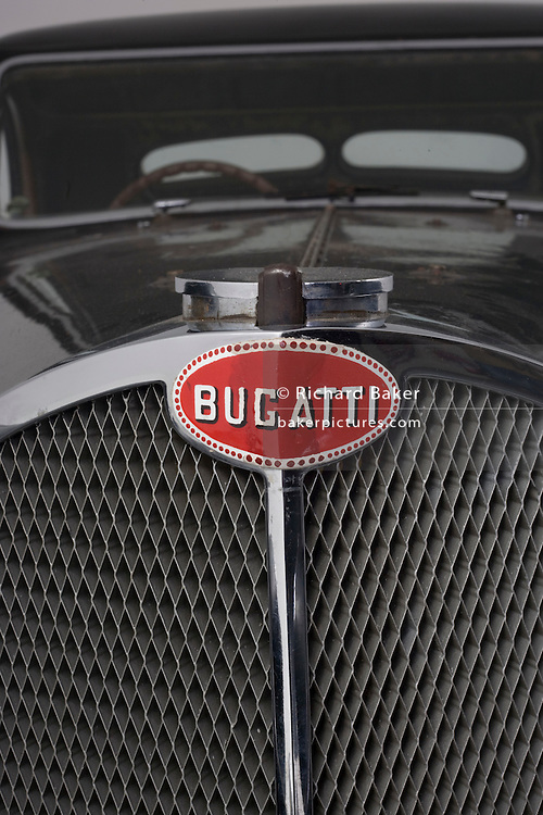 Found in a garage where it had been stored virtually untouched for 50 years, this 1937 Bugatti Type 57s Atalante sports car is previewed for the first time before a Bonhams auction in Paris on February 7th 2009. Here, we see a detail of its radiator grill in a garage/studio before the auction and sale in Paris. In 2008 the Bugatti Type 57S with chassis number 57502 built in 1937 with the Atalante coachwork for Earl Howe was discovered in a private garage in Newcastle upon Tyne, having been stored untouched for 48 years and known about only by a select few people. It was auctioned in February 2009 at the Retromobile motor show in Paris, France, fetching EUR3.4 million (US$4.6 million), becoming one of the highest valued cars in automotive history, owing much to its extremely low mileage, original condition and ownership pedigree.
