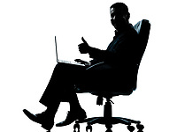 one caucasian business man computer computing thumb up sitting in armchair silhouette Full length in studio isolated on white background