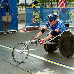 wheelchair athlete crosses finish line