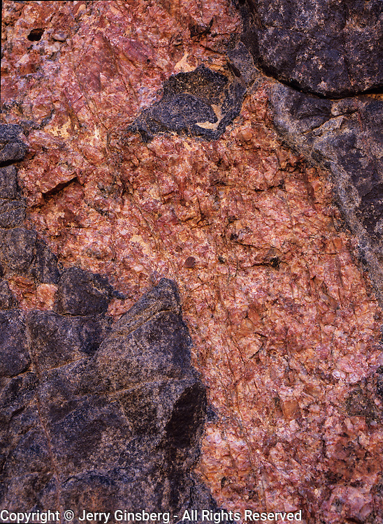 Pink granite at Deer Creek beside the Colorado River deep in the inner gorge of the Grand Canyon, Grand Canyon National Park, AZ.