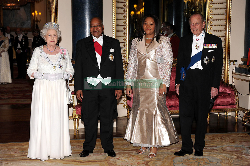 Queen Elizabeth II and the Duke of Edinburgh accompany the President of South Africa, Jacob Zuma (centre) and his wife Tobeka Madiba Zuma during a state banquet at Buckingham Palace, this evening.
