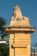 The entrance gate to Chateau Beychevelle in Saint Julien. Lion statue on the gate post.