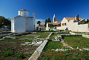 The pre-Romanesque church of the Holy Cross (Sv Kriz), reputed to be the smallest cathedral in the world, sitting amongst ancient ruin foundations. Nin, Croatia