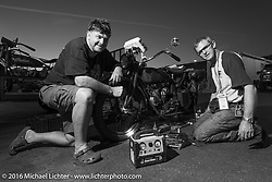 Hans Coertse working on his bike after Stage 14 - (284 miles) of the Motorcycle Cannonball Cross-Country Endurance Run, which on this day ran from Meridian to Lewiston, Idaho, USA. Friday, September 19, 2014.  Photography ©2014 Michael Lichter.