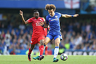 David Luiz of Chelsea is intercepted by Ahmed Musa of Leicester City. Premier league match, Chelsea v Leicester city at Stamford Bridge in London on Saturday 15th October 2016.<br /> pic by John Patrick Fletcher, Andrew Orchard sports photography.