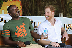 Prince Harry on stage during a visit to 'Nature Fun Ranch', which allows young people to speak freely with one another about important topics, including HIV/AIDS, providing them with a positive focus to guide their lives in the right direction, during his tour of the Caribbean.