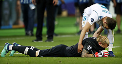(L-R) Goalkeeper Loris Karius of Liverpool FC lies dejected on the ground after last whistle, Nacho of Real Madrid CF during the UEFA Champions League final between Real Madrid and Liverpool on May 26, 2018 at NSC Olimpiyskiy Stadium in Kyiv, Ukraine
