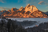 The Tetons glow in the light of sunrise on a frosty morning while the Snake River flows quietly below. It is this exact view that I used to create my logo/watermark. One of the reasons the Tetons are so majestic is because this range has no foothills. The mountains rise abruptly 7,000 feet above the valley floor in only about 3 miles. On long winter nights cold air tends to slide down the steep slopes and becomes trapped under an inversion layer in the Jackson Hole Valley. With the Tetons to the west, Absarokas to the north, and the Gros Ventre mountains to the east, the air has nowhere to go. This leads to some seriously cold temperatures. In the last month alone it has reached -20°F or colder on 7 mornings. In 1933 the temperature here dropped to a bone-chilling -66°F, making it among the coldest temperatures ever measured in the US outside of Alaska.