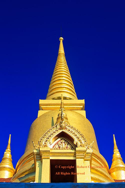 Gold Stupa on Blue: The brilliantly gold stupa rises into a series of converging circles, set against a vibrantly blue sky, Tritotsathep Temple, Bangkok Thailand.