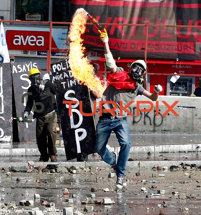 A protestor throws a molotov cocktail at riot police during clashes at Taksim Square Istanbul, Turkey, 11 June 2013. Demonstrations against the Islamic-conservative government of Prime Minister Recep Tayyip Erdogan began on 31 May when a police crackdown against a peaceful sit-in staged by environmentalists angered over a development project in Istanbul escalated into larger battles between law enforcement and demonstrators. Photo by AYKUT AKICI/TURKPIX