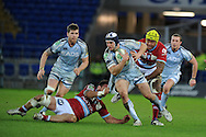 Sam Warburton of Cardiff Blues is tackled by  Juan Pablo Orlandi (l) and Jone Qovu Naliko ®.  Heineken cup, Cardiff Blues v Racing Metro at the Cardiff city stadium in Cardiff, South Wales  on Sunday 22nd  Jan 2012. pic by Andrew Orchard, Andrew Orchard sports photography,