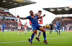 Stoke City's Ramadan Sobhi (right) and Leicester City's Danny Simpson battle for the ball