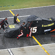 Crew members of the Clint Bowyer (15) team push his race car back to the garage at the conclusion of the 56th Annual NASCAR Coke Zero 400 race at Daytona International Speedway on Sunday, July 6, 2014 in Daytona Beach, Florida.  (AP Photo/Alex Menendez)