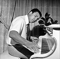 Mohammed Ali also known as Cassius Clay and 'The Greatest'. Heavyweight boxing champion seen playing his piano at his home in Chicago, USA in 1977. Photographed by Terry Fincher