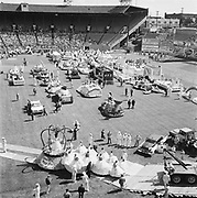 Y-590613-D4-04. towing Queen's float uphill leaving Multnomah Stadium. Rose Festival Grand Floral Parade, June 13, 1959