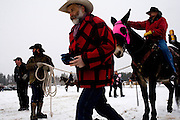 Cowboys prepare for competition at the World Skijoring Championships in Whitefish, Montana on Saturday, January 28. <br /> (REUTERS/Matt Mills McKnight (UNITED STATES)