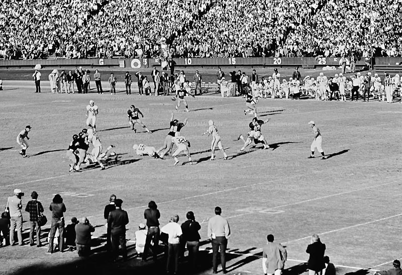 COLLEGE FOOTBALL:  Stanford quarterback Don Bunce #11 throws a pass during the 1971 Big Game against Cal played on November 20, 1971 at Stanford Stadium in Palo Alto, California.  Stanford won by a score of 14-0.  BW R130-