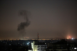 March 27, 2019 - Gaza, Palestine Territories, Palestine - Smoke billows above buildings in Rafah in the southern Gaza Strip during Israeli strikes on March 27, 2019. - Palestinian militants fired three rockets at Israel overnight prompting retaliatory fire from Israel, with the exchanges threatening a Hamas-declared truce. They came after Prime Minister Benjamin Netanyahu said he was prepared for further military action in Gaza, at a highly sensitive time ahead of Israel's April 9 elections. (Credit Image: © Abed Rahim Khatib/NurPhoto via ZUMA Press)