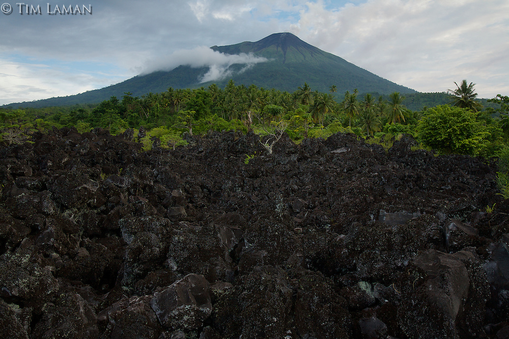 Mount Gamalama volcano.  Active volcano on Ternate Island, with lava in the foreground from an eruption in the 1800's.