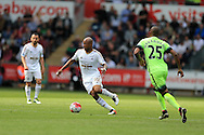 Andre Ayew of Swansea city breaks away from Fernandinho of Manchester city (r).Barclays Premier league match, Swansea city v Manchester city at the Liberty Stadium in Swansea, South Wales on Sunday 15th May 2016.<br /> pic by Andrew Orchard, Andrew Orchard sports photography.