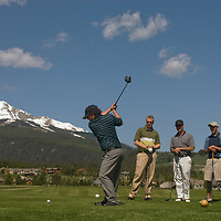 Keith Word tees off at Big Sky Golf Course in Big Sky, Montana while Chad Jones, Shane Knowles & Sam Woodger watch.