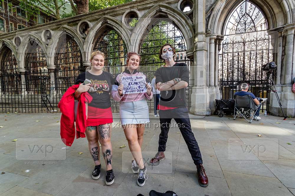 """Chloe Fawkes, 21 (Left in the picture), who works as a waitress from Reading said she became a fan of Jonny Depp since she was five, with the film """"Pirates of the Caribbean."""" Along with her twin sister,, Ruby Fawkes 21 (Centre in the picture) they said they're here to support Depp's efforts in the trial with love. <br /> <br /> Chloe and Ruby also met with another young man Jack, 23 (Right in the picture) from London, who works in a bar. Jack said Depp had become his hero since he was eight. """"I enjoy his characters and I relate by similar circumstances in my life,"""" he said. Jack also said that he thinks he is funny, but he confirms """"he is not.""""<br /> For all three of them, this is the first day to be here. They all think they will be back for the final day. (VXP Photo/ Vudi Xhymshiti)"""