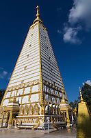 Wat Nong Bua has a unique, large white angular chedi, a replica of the Mahabodhi Bodhgaya in India where the Buddha found enlightenment.  The structure was built in 1957 to commemorate the 2500 anniversary of the death of Buddha.  The walls are beautifully carved scenes of Buddhist scriptures.