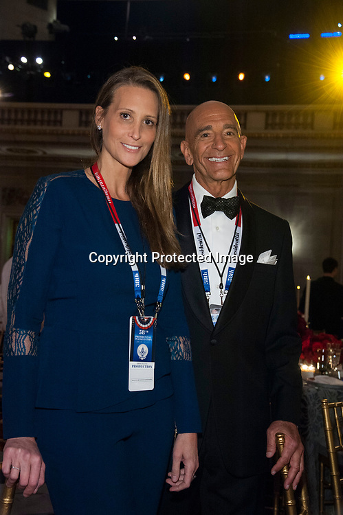 Stephanie Winston Wolkoff, and Tom Barrack, chairman of the Presidential Inaugural Committee, pose for a photo during the Chairman's Global Dinner at the Andrew W. Mellon Auditorium in Washington DC on January 17, 2017.
