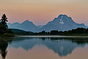 Mount Moran and the Grand Teton mountains reflected on the Snake River at Oxbow Bend during dawn at the Grand Teton National Park in Moran, Wyoming.