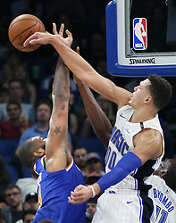 November 8, 2017 - Orlando, FL, USA - The Orlando Magic's Aaron Gordon, right, blocks the shot of the New York Knicks' Kyle O'Quinn, left, at the Amway Center in Orlando, Fla., on Wednesday, Nov. 8, 2017. The Magic won, 112-99. (Credit Image: © Stephen M. Dowell/TNS via ZUMA Wire)