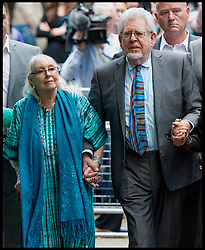 Image ©Licensed to i-Images Picture Agency. 30/06/2014. London, United Kingdom. Rolf Harris guilty of sex assaults leaves Southwark Crown Court with his wife  Picture by i-Images