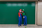 Two Japanese women dressed as Mario and Luigi take a selfie in Shibuya station during the Halloween celebrations Shibuya, Tokyo, Japan. Saturday October 27th 2018. The celebrations marking this event have grown in popularity in Japan recently. Enjoyed mostly by young adults who like to dress up, drink , dance and misbehave in parts of Tokyo like Shibuya and Roppongi. There has been a push back from Japanese society and the police to try to limit the bad behaviour.