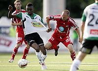 Fotball<br /> Tippeliga 2010<br /> 01.08.2010<br /> Hønefoss v Odd Grenland 2:1<br /> Foto: Morten Olsen, Digitalsport<br /> <br /> Jone Samuelsen - Odd<br /> Umaru Bangura - Hønefoss
