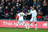 Martin Olsson of Swansea city ® celebrates with teammate Jack Cork after he scores his teams  2nd goal to make it 2-2. Premier league match, Swansea city v Burnley at the Liberty Stadium in Swansea, South Wales on Saturday 4th March 2017.<br /> pic by Andrew Orchard, Andrew Orchard sports photography.