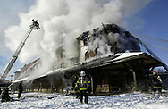 Firefighters battle a fire at the rear of the O&W Station building in Middletown yesterday morning. The rear of the historic former railroad station was damaged. tbthr.RAILROAD STATION FIRE.