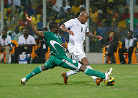 Photo: Steve Bond/Richard Lane Photography.<br />Ghana v Nigeria. Africa Cup of Nations. 03/02/2008. Joseph Yobo (L) times his tackle perfectly on Junior Agogo (R)
