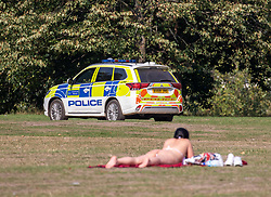 "© Licensed to London News Pictures. 15/09/2020. London, UK. Police patrol Hyde Park enforcing the ""Rule of Six"" as sunbathers enjoy the warm sunshine this afternoon as the mini-heatwave continues in the South East of England with highs of 29c. Prime Minister Boris Johnson announced last week that gatherings of more than six people will be banned from Monday (yesterday) in the hope of reducing the coronavirus R number. Photo credit: Alex Lentati/LNP"