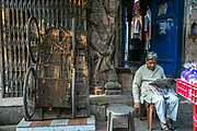 A man reads his morning newspaper outside an old Haveli in Sitaram Bazar, Old Delhi, India.