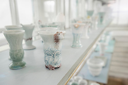 Porcelain vases on shelf in a glass house, Bavaria, Germany
