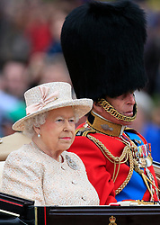 Queen Elizabeth II and the Duke of Edinburgh leave Buckingham Palace in a horse drawn carriage to attend Trooping the Colour at Horse Guards Parade, London.