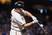 San Francisco Giants catcher Nick Hundley (5) swings at a Los Angeles Dodgers pitch at AT&T Park in San Francisco, California, on September 13, 2017. (Stan Olszewski/Special to S.F. Examiner)