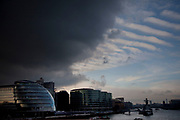 City Hall, home of the Mayor of London, and local politics, under heavy clouds over the River Thames.