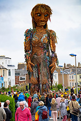 North Berwick, Scotland, UK. 15th August  2021. Giant Giant puppet Storm walks along seafront of North Berwick as part of the Fringe by the Sea festival in the town. <br />  Storm is an outdoor theatrical event to mark Scotland's Year of Coasts and Waters 20/21.  Iain Masterton/Alamy Live news.