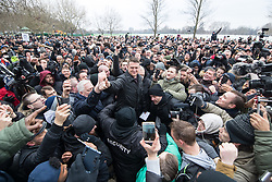 """© Licensed to London News Pictures . 18/03/2018 . London , UK . TOMMY ROBINSON (centre) arrives . Alt-right groups , including Generation Identity , and antifascist opponents , demonstrate at Speakers' Corner in Hyde Park where Tommy Robinson reads a speech by Generation Identity campaigner Martin Sellner . Along with Brittany Pettibone , Sellner was due to deliver the speech last week but the pair were arrested and detained by police when they arrived in the UK , forcing them to cancel an appearance at a UKIP """" Young Independence """" youth event , which in turn was reportedly cancelled amid security concerns . Photo credit: Joel Goodman/LNP"""