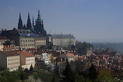 Prague Castle looms over the Little Quarter from Petrin Hill Prague, Czech Republic. The castle, first constructed in the 10th century is the seat of government in the Czech Republic.