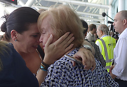 October 3, 2017 - Fort Lauderdale, Florida, U.S.- Families of Caribbean hurricane evacuees who arrived on board the Royal Caribbean Adventure of the Seas, greet their relatives, Tuesday,  at Port Everglades. More than 3,000 people from Puerto Rico and the U.S. Virgin Islands were brought to Florida on board the cruise ship. (Credit Image: © Joe Cavaretta/TNS via ZUMA Wire)