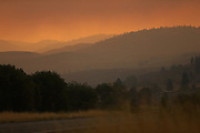 The sun barely illuminates the land under a thick fog of red smoke as seen from Highway 97 just south of Okanogan Friday August 21, 2015.<br /> <br /> Bettina Hansen / The Seattle Times