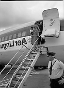 Vietnam Refugees Arrive .09/08/1979.08/09/1979.9th August 1979.Photograph shows Aer Lingus cabin crew helping the refugees as they leave the plane at Dublin Airport.